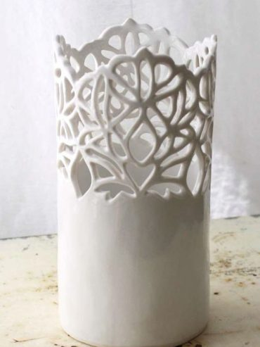 Cut out cylindrical vase